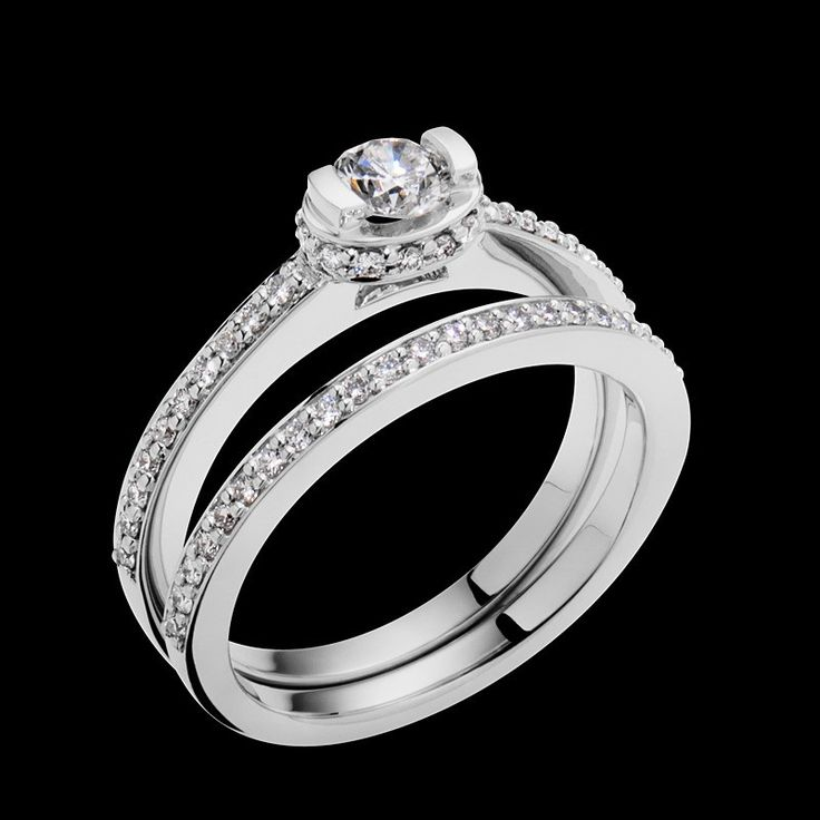 """""""Elation"""" has diamonds hugging the oval setting that holds the center round brilliant diamond. This ring has a 0.25 carat round brilliant center diamond."""