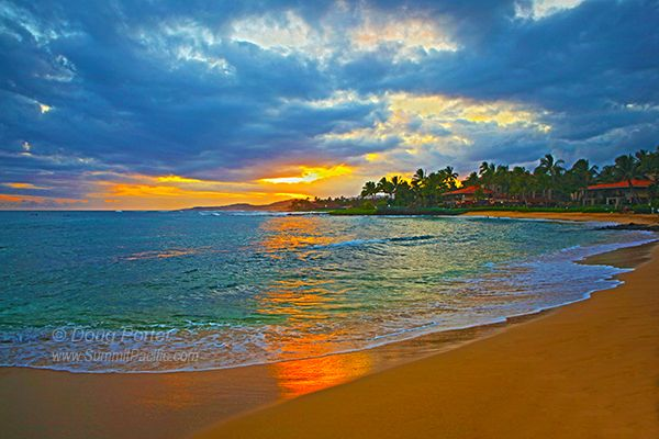 Poipu Beach on the south shore of Kauai is popular with locals and tourists for swimming, sunning, and just hanging out.
