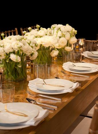 At Eric Warner's golden-hued table for Aesthete Ltd., each plate had the image of a gold ribbon. Small LED votives immersed in gold glitter... PHOTO: EMILY GILBERT FOR BIZBASH