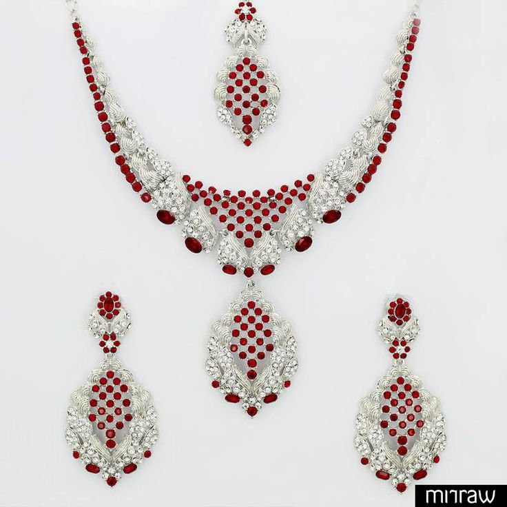 A stunning designer necklace set with earrings and maang tika
