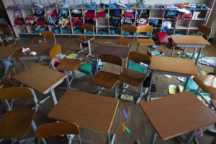 The desks, backpacks, and school supplies of children are abandoned inside an earthquake-rattled primary school classroom in Namie, Japan. Months have gone by since the students fled following the March 11 earthquake and it is uncertain when, or if ever the children will be able to return or reclaim their possessions.