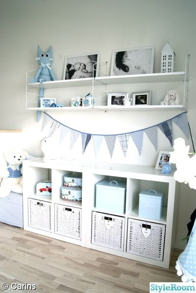 Blue and white baby room. Bunting flags. Rabbit lamp.