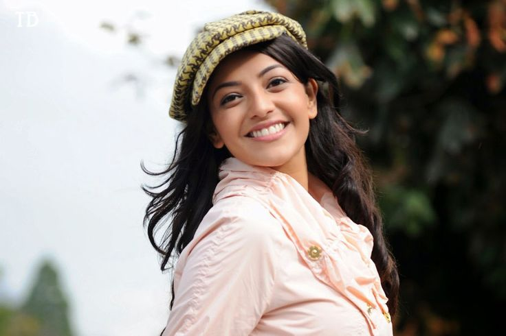 kajal agarwal wearing a cafe on head. http://www.wallpapergroups.com/2014/07/bollywood-actress-kajal-agarwal-hd-photo-free-download.html
