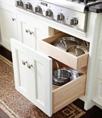 Pull out double decker pots and lids cabinet under 36 inch gas cooktop.