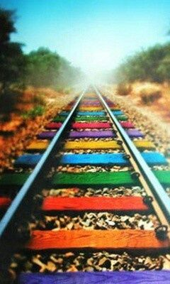 Rainbow colourful railroad tracks: the pleasure of a journey through wonderful country.