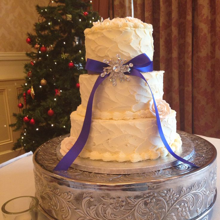 Soft iced 3 tier wedding cake simply decorated with ribbon and diamante brooch. www.kellylou.com