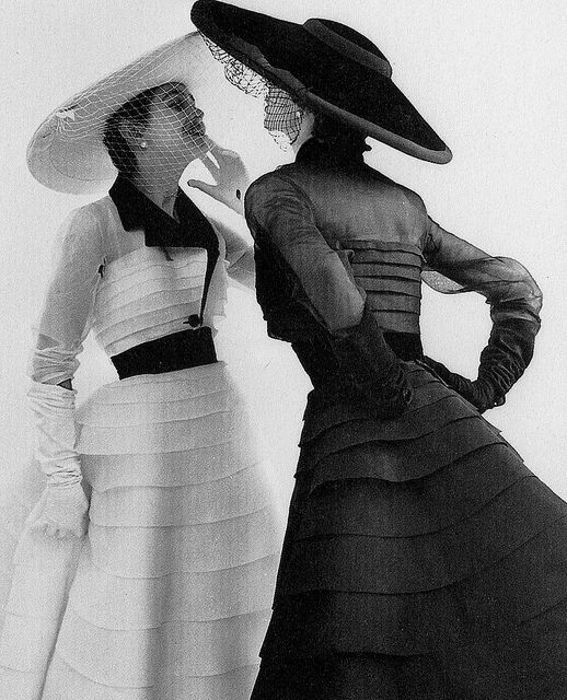 White and black takes on the same wonderfully lovely Jacques Fath design. 1950's