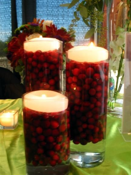 Cranberries and candles in a vase of water how pretty for