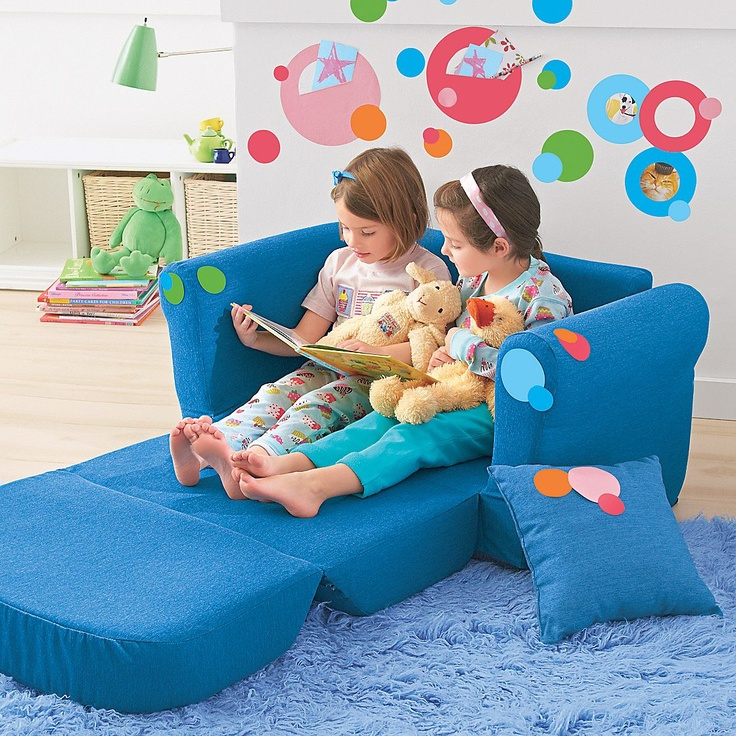 Denim kid-size sofa that folds out to a bed. Perfect for the basement...