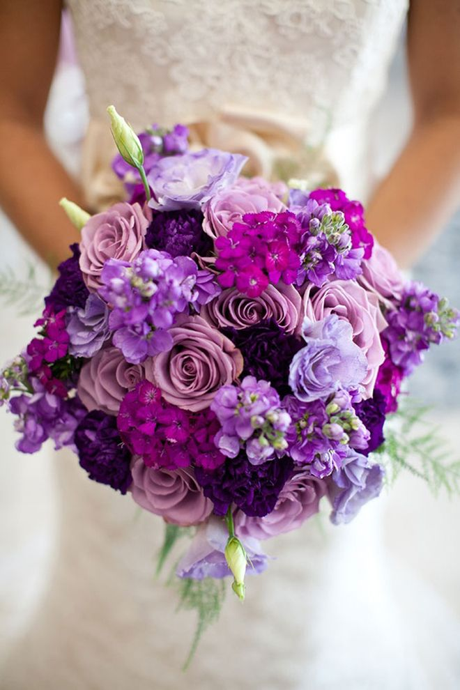 Purple, purple, and more purple! Lavender, violet, and eggplant bouquet feauring roses, stock, lisianthus, dianthus, and carnations.