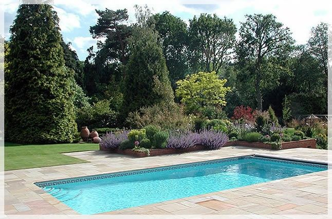 Swimming pool pictures bing pool cement pond for Simple swimming pool designs