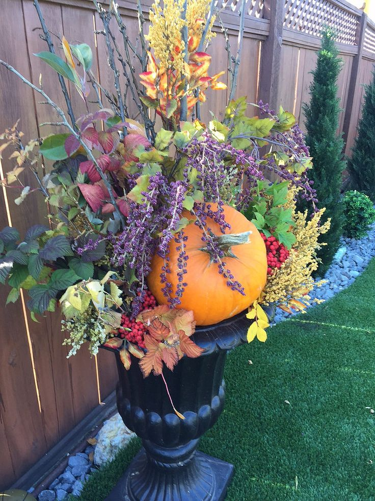 outdoor harvest decorations in black urn