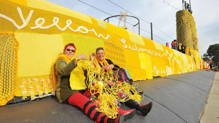 ALL STITCHED UP: The Holbrook community bind together to transform their submarine from drab to fab with a lovely yellow coat. Picture: Kieren L Tilly
