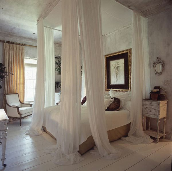 A pretty French Farmhouse inspired bedroom uses soft, filmy curtains around the bed as a focal point. (via desire to inspire - desiretoinspire.net - More fromSera)