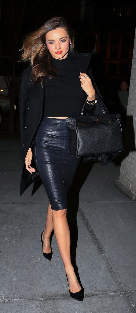Need another reminder that black leather isn't all tough? Miranda Kerr put a supersexy spin on it, wearing a pencil skirt with black pumps and a high-neck top.