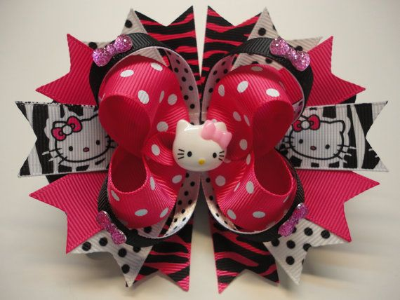 HELLO KITTY Boutique Stacked Hair Bow  Bow measured Approximately W 5.0 x L 4.5 x H 2.0 at the widest point. Made of High Quality Grosgrain Ribbon. Ends are Heat Treated to prevent fraying.  Choice of Clip ..... 50mm Partially Lined French Style Barrette.  ..... 55mm Partially Lined