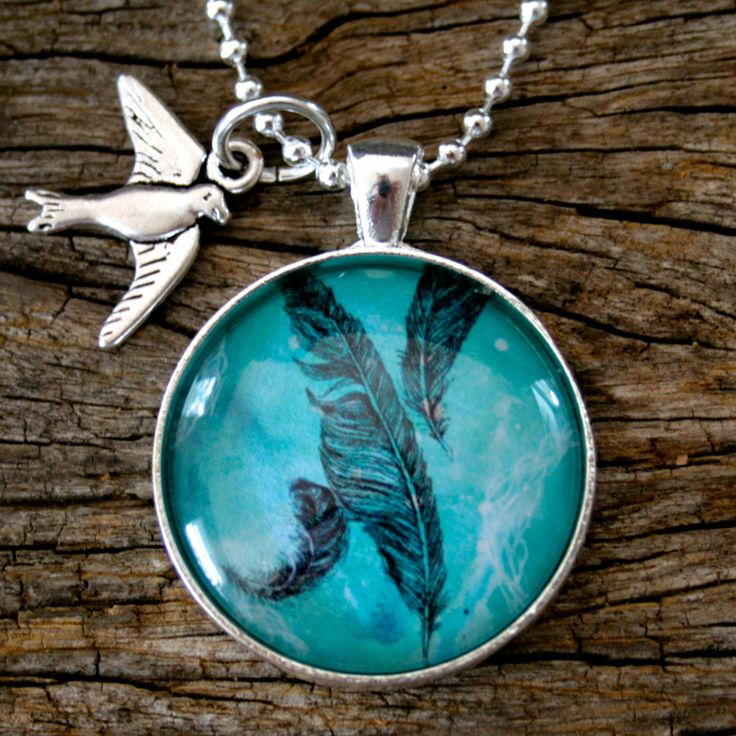 Feather pendant with bird silver charm necklace by Nest of Pambula available at Ari Liv, jewellery Shop www.ariliv.com.au