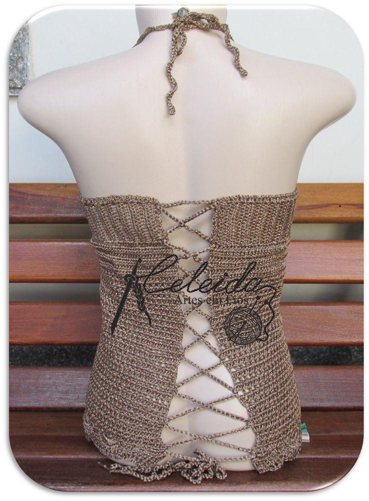 Blusa de crochê na cor bronze, com detalhes de franja no decote e acabamento de babadinho.Ficou maravilhosa, uma peça nina elegante !!   Us...