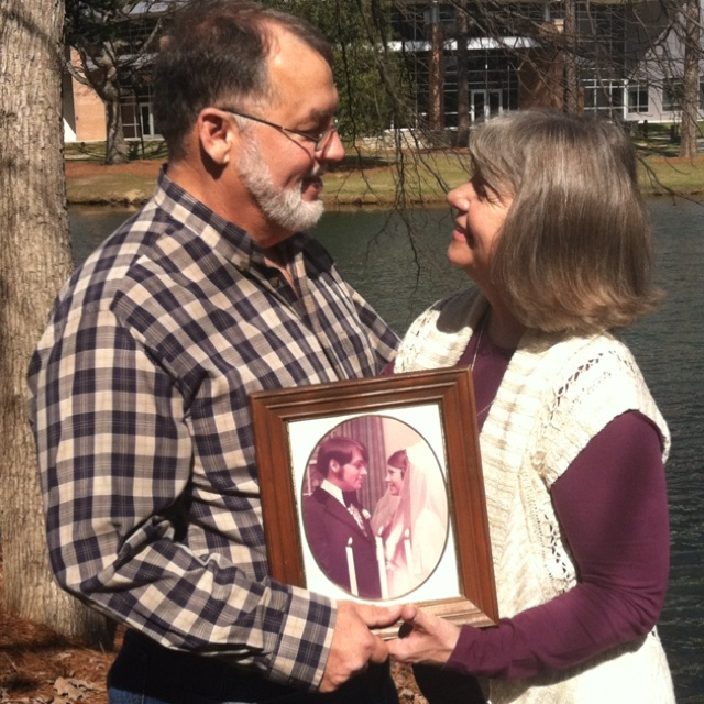 Pinterest photo idea...my mom and dad on their 40th wedding anniversary holding their wedding photo. <3