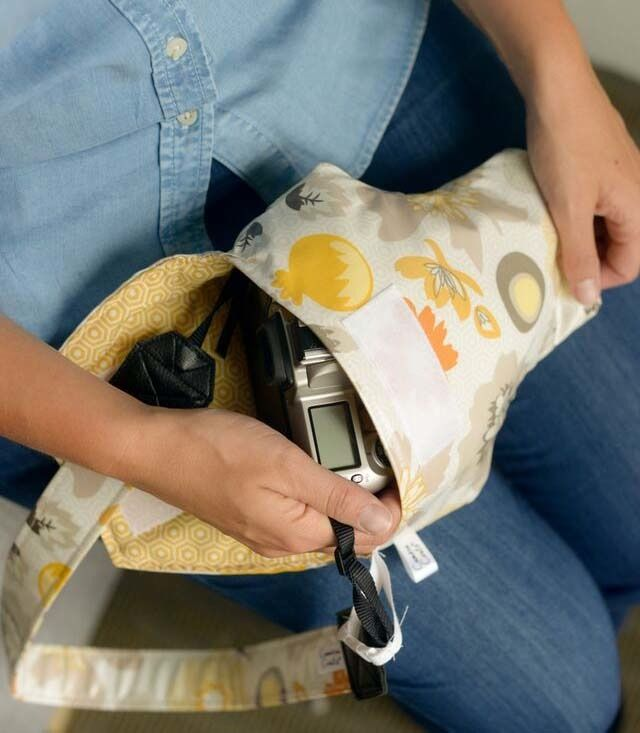 Camera Bags are big and bulky, Camera Coats are cute and easy! This sweet gray and yellow floral Camera Coat is *waterproof, padded, & ready to...