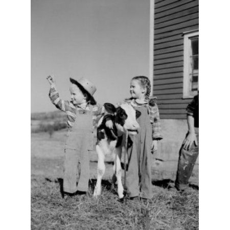 Boy and girl standing with calf on farm Canvas Art - (18 x 24)