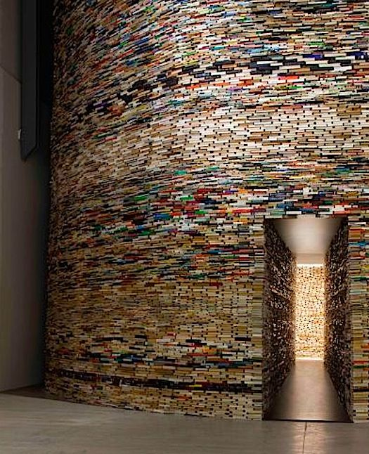 The Scanner by Matej Kren,an installation at the Museum of Modern Art in Bologna, is a tower made of thousands of thin books. Inside is a tunnel lined with mirrors creating the illusion of an infinite number of books.