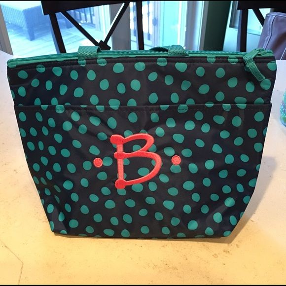 Thirty One lunch bag This is a Thirty One lunch bag. I don't think I've ever even used it, great condition. It is navy with green polka dots. It is embroidered with a pink B. Thirty One Other
