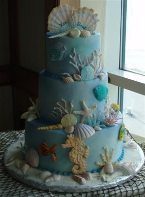 Ice Blue bleach wedding cake. Love the different shells on the cake!