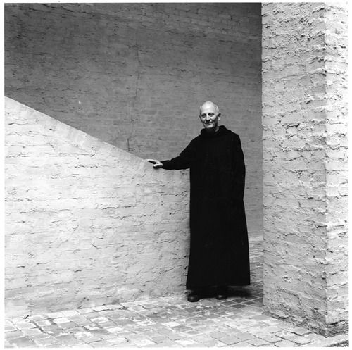 The monk architect,Dom Hans van der Laan,standing in the central stair of hisAbbey Church of St. BenedictusberginVaals, 1967.