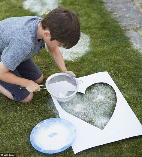 All you need to decorate the lawn is a large pieces of cardboard, a pen or pencil, craft scissors, flour and sieve