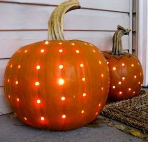 pumpkin carving ideas inspiration, seasonal holiday d cor, thanksgiving decorations, Use a drill with a small bit to create these polka dotted pumpkins lit from within