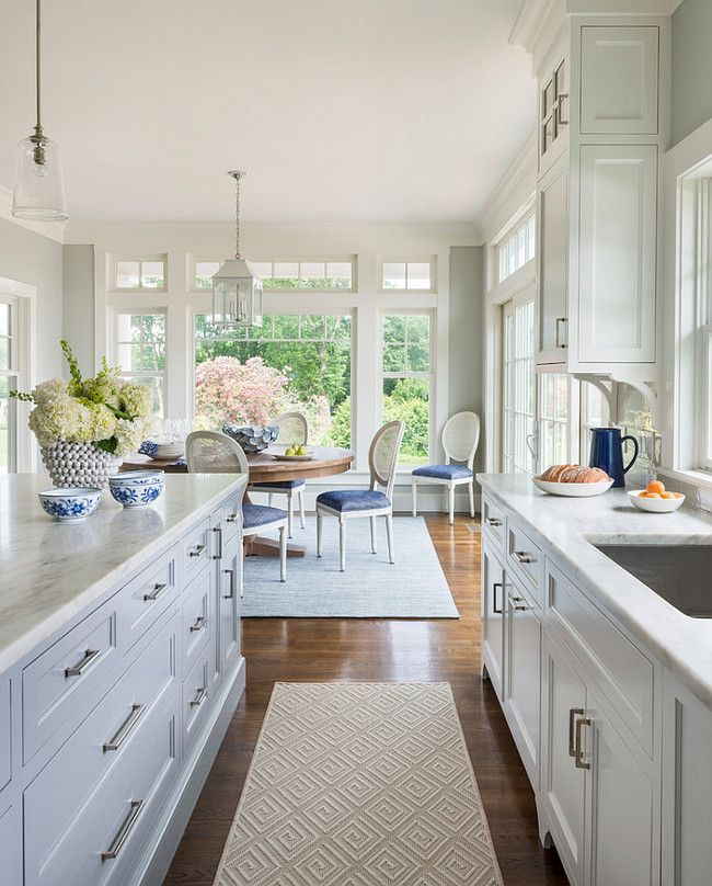 Open white kitchen and breakfast nook