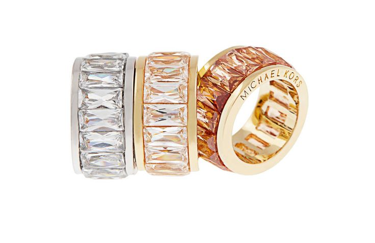 Michael Kors gold and neutral rings.