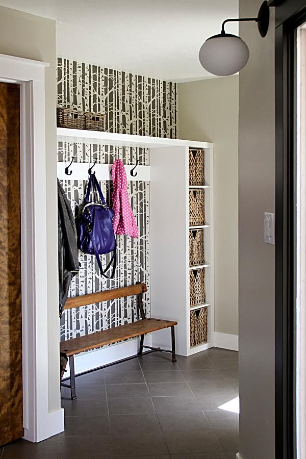Bold wallpaper and handy storage areas make this small entry beautiful and functional.