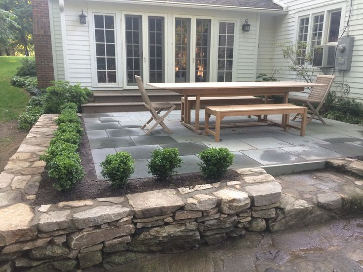 Bluestone Thermal Flagstone Patio Set In Stonedust With Perimeter Stonewall  And Boxwood Plantings