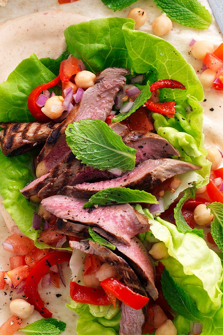 Excite your tastebuds with these delicious moroccan lamb and chickpea wraps- bursting with flavour the whole family will love! Recipe by the Australian Women's Weekly.