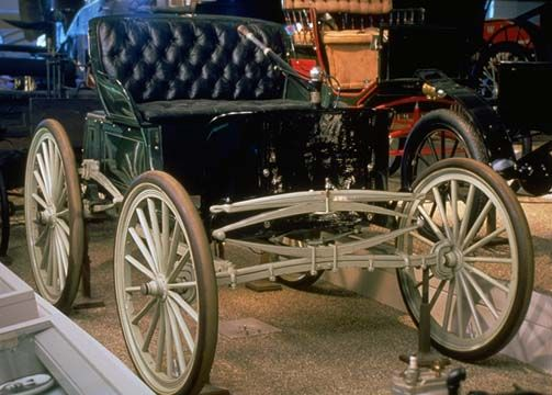 1896 Duryea. First production vehicle in America. Built by brothers Charles and J. Frank Duryea. The Duryea Motor Wagon Company hand-assembled 13 identical motor vehicles. Of the 13 automobiles, this is the only known survivor. (Henry Ford Museum).