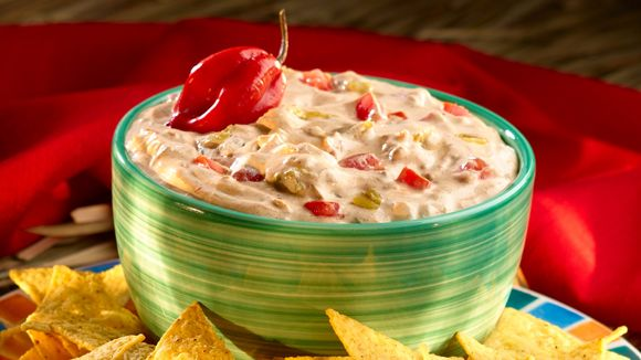 Get the party started with our zesty chili dip recipe! Packed with mouthwatering Mexican flavor thanks to spicy green chilies and chili powder, this recipe is guaranteed to be a hit.