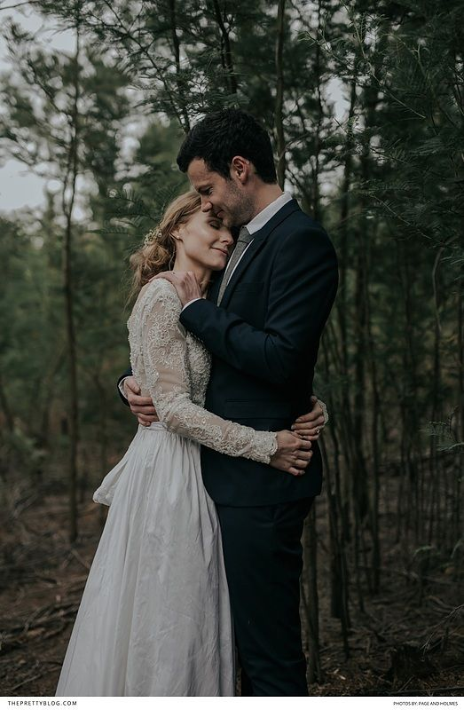 Winter forest wedding with a vintage inspired lace dress and black grooms suit! https://www.theprettyblog.com/wedding/misty-mountain-mornings-in-the-drakensberg/?utm_campaign=coschedule&utm_source=pinterest&utm_medium=The%20Pretty%20Blog&utm_content=Misty%20Mountain%20Mornings%20in%20the%20Drakensberg