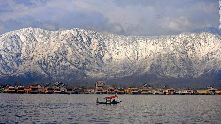 """<strong>Dal Lake, Srinagar:</strong> Known as the """"jewel in the crown"""" of Indian-administered Kashmir, Dal Lake is a Srinagar must-visit. Lined by beautiful gardens and snowcapped mountains, the lake is best toured while riding a traditional wooden shikara, Srinagar's version of the gondola."""