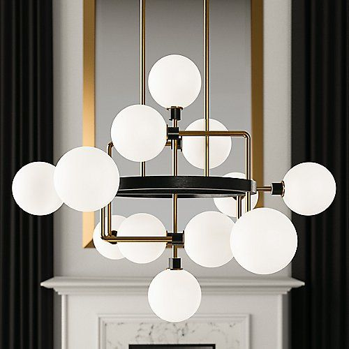 The Viaggio Chandelier by Tech Lighting is a quirky blend of industrial and mid-century modern design. Its unique silhouette features a random assortment of Glass orbs (with sleek Black sockets) which are supported by solid Metal arms that extend and bend from an inner Black ring. Each glass orb contains an LED bulb which, once lit, produces a long-lasting warm output. A fun, eye-catching centerpiece for entryways, dining areas, and open living spaces.