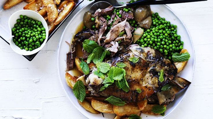 Slow-roasted lamb with tarragon, peas and crispy potatoes