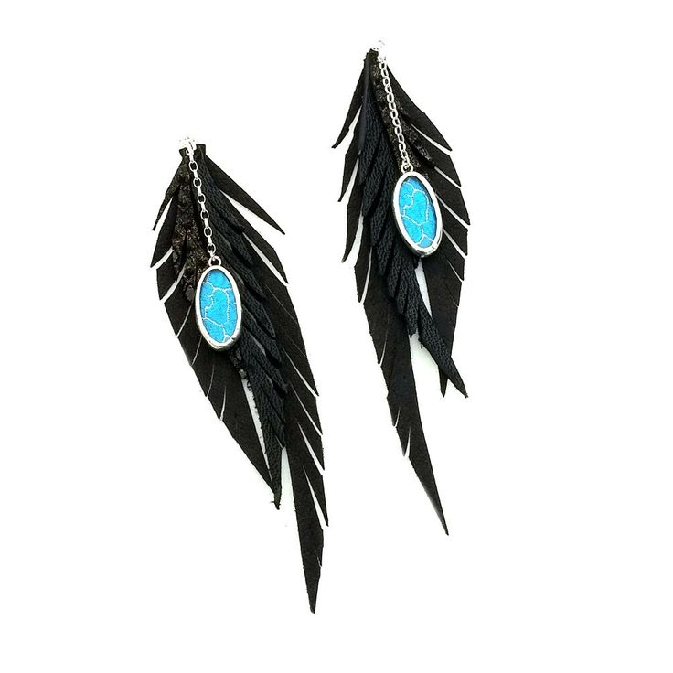 I love these black leather feathers earrings with the turquoise silk Shi piece. Have a pair like this custom made, just ask!