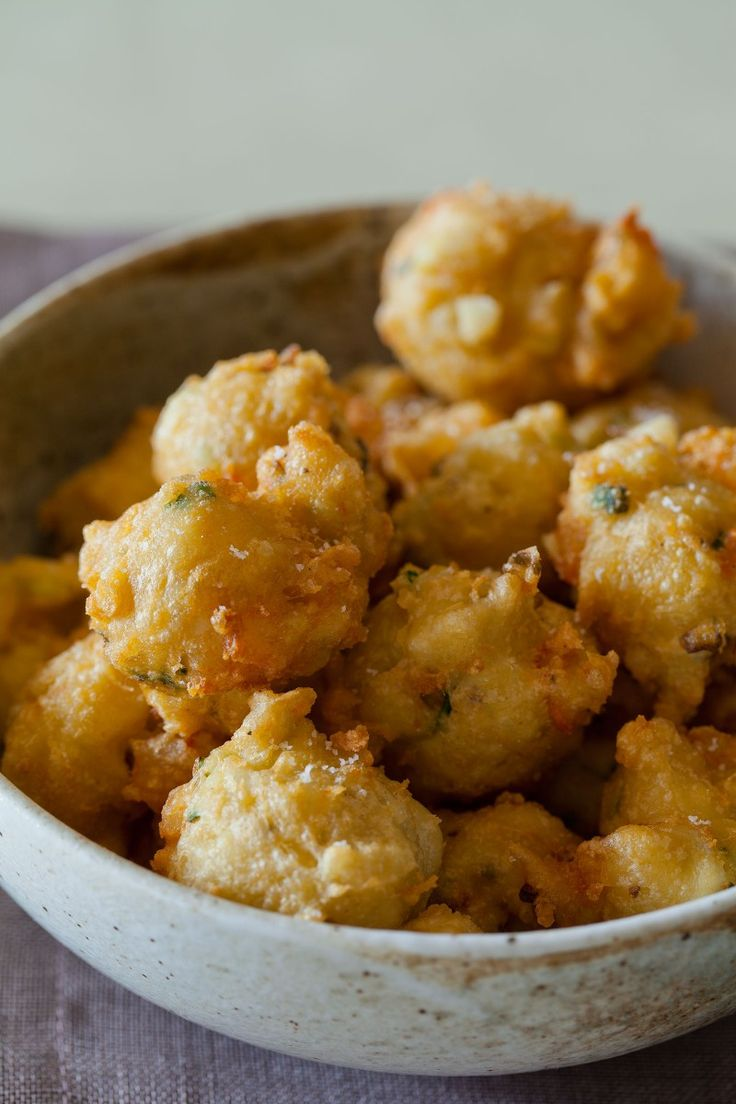 Our Shrimp Fritters recipe are the ideal appetizer. These little fritters are light and fluffy, and paired with a spicy honey drizzle.