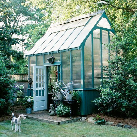 Gorgeous teal greenhouse with tall roof