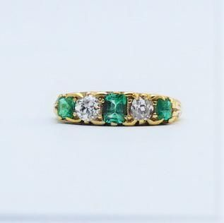 Art Deco Emerald and Diamond Five Stone Ring.