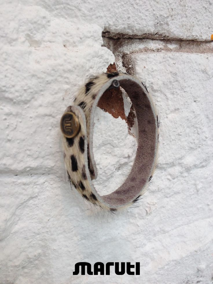 MARUTI bracelets are handmade from printed cow hair on leather. Created from the leftover materials for our shoes. Each bracelet is unique. www.marutifootwear.com