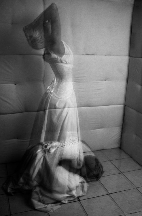 Slinka photographed by Sarah Thompson | corset dress | fine art photography | movement | long exposure | black  white | padded walls | emotion |