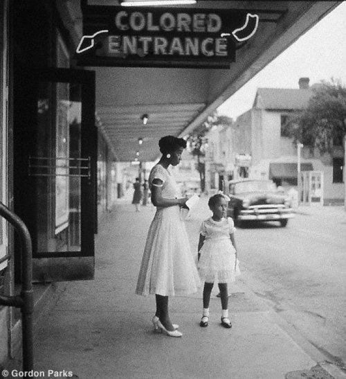 """The """"Colored Entrance"""" of a department store in Birmingham, Alabama, only 56 years ago. Photo by Gordon Parks circa 1956. The dubious distinction of designated separate entrances based on race was an accepted practice in the south regardless of the fact that everyone's money looked and spent the same way."""