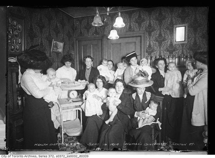 Woman's Dispensary, 18 Seaton Street - Baby Clinic  September 16, 1914  Fonds 200; Former City of Toronto fonds Series 372; Dept. of Public Works photographs Subseries 32; Health Department photographs  (Second woman from right - back row - Possibly Alma Marks formerly of Liskeard and son Walter)